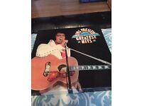 Elvis Presley greatest hits mint and and music legends Elvis Presley and figure rare