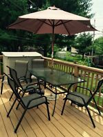 Patio table and chairs + storage bin