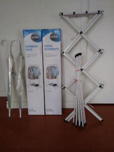 2 Umbrellas new - 2 Garment racks new -  1 Clothes drying rack