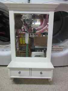 White mirror with drawers
