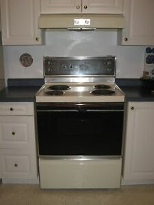 "30"" GE  stove and range hood, beige color"