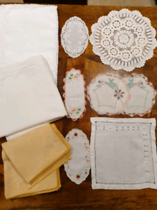 Assortment of table toppers, placemats and napkins
