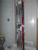 4 PAIRS OF CROSS COUNTRY SKIS AND POLES.
