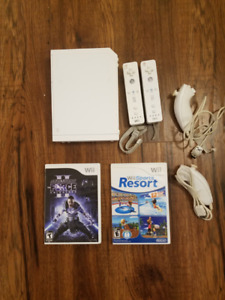 Wii with 2 controllers, 5 games, all hookups