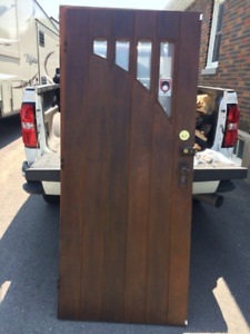 Beautiful antique solid wood exterior door with beveled glass