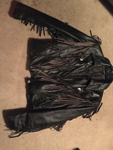 black leather jacket with fringes and black leather chaps
