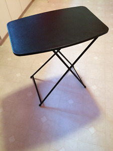 Folding adjustable table