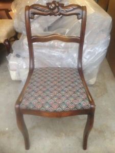 Antique armless chair with carving