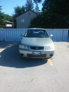 2002 gxe nissan sentra with summer and winter tires on rims