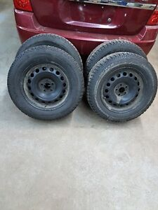 4- 215 65 16  Like new Michelin X-Ice & steel Rims. Dodge
