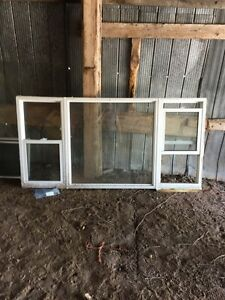 "Vinyl window, new. 83"" wide x 41"""