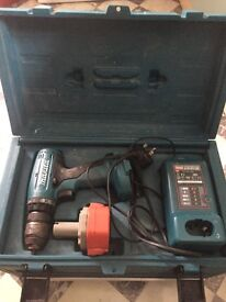 Makita drill, battery, battery charger and case