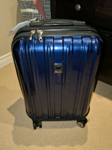 "19"" Blue Delsey Aero Carry-On Spinner Trolley luggage."