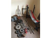 Variety of Weights, Bars and a Bench