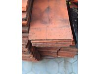 Reclaimed used clay roof tiles