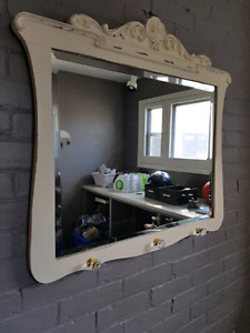 "Antique Mirror - 34""w x 31""h at the deepest points"
