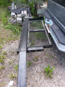 Receiver-hitch mounted cargo deck with ramp