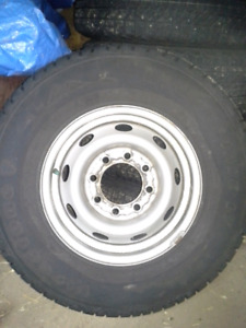 Studded Firestone 245/75R16 snow tires and rims. Set of four