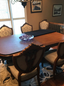 Elegant Dining Table and 8 Chairs