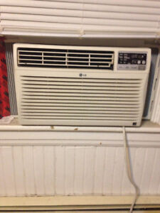 3 working LG air conditioners, with remotes and manuals