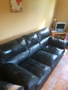 Selling a leather couch and chair set