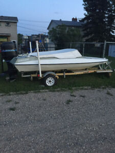 Boat with motor and trailer