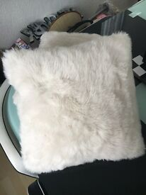 White fur cushions