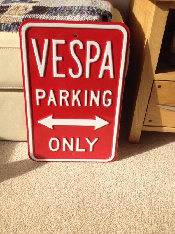 Vespa parking only sign