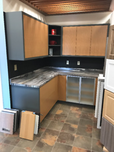 Showroom display model for sale!! Oak cabinets with laminate top