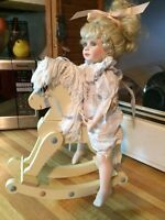 Porcelain doll with rocking horse