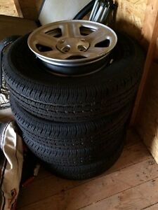 "Barely used 16"" wrangler tires and rims"