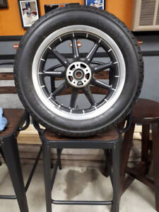 A Metzeler front tire and rim off 2001 HD ULTRA CLASSIC