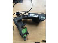 Electric chainsaw sharpener.