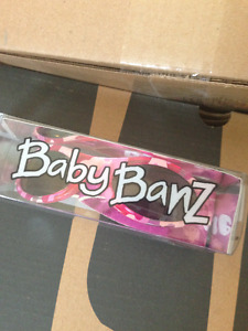 New condition Baby Banz sunglases, pink camo
