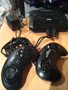 SEGA GENESIS w/ 2 different controllers and power cable.