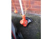 Black and decker strimmer like new