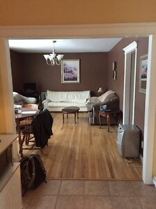 Available May 1st  three bedroom house, five minutes MUN