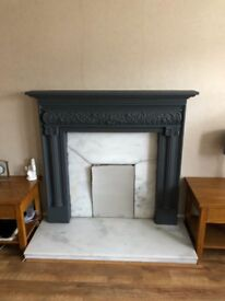 Marble fireplace with moulded mantelpiece.
