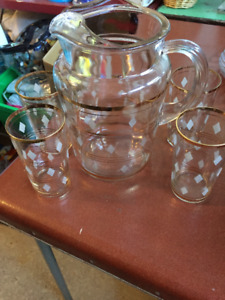 ANTIQUE GOLD RIMMED PITCHER AND SIX GLASSES