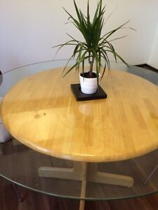 Solid wood table with glass