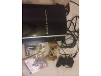 PS3 with 3 game and 2 controllers very good condition