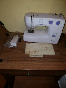 Sewing table for sewing machine