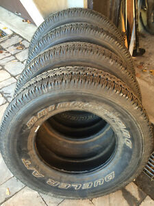 4 PNEUS / 4 ALL SEASON TIRES   265/70/17 BRIDGESTONE DUELER