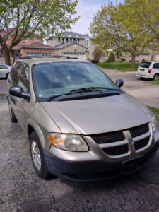 2004 metallic gold Dodge Caravan