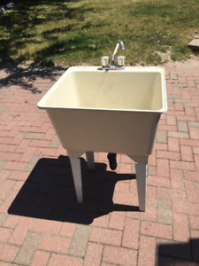 Laundry tub with faucet