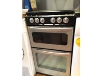 Freestanding double cooker with oven, hob and grill. 60cm