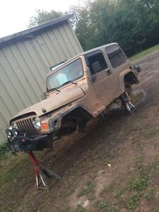 Parting out this jeep 4.0 5 speed also 2.5 parts
