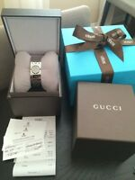 Gucci watch Twirl brand new box, receipt from Birks