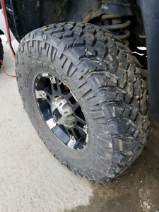 35x12.50 17 Nitto Trail grapplers 85%-90% left tread with rims