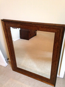 Large wood framed wall mirror
